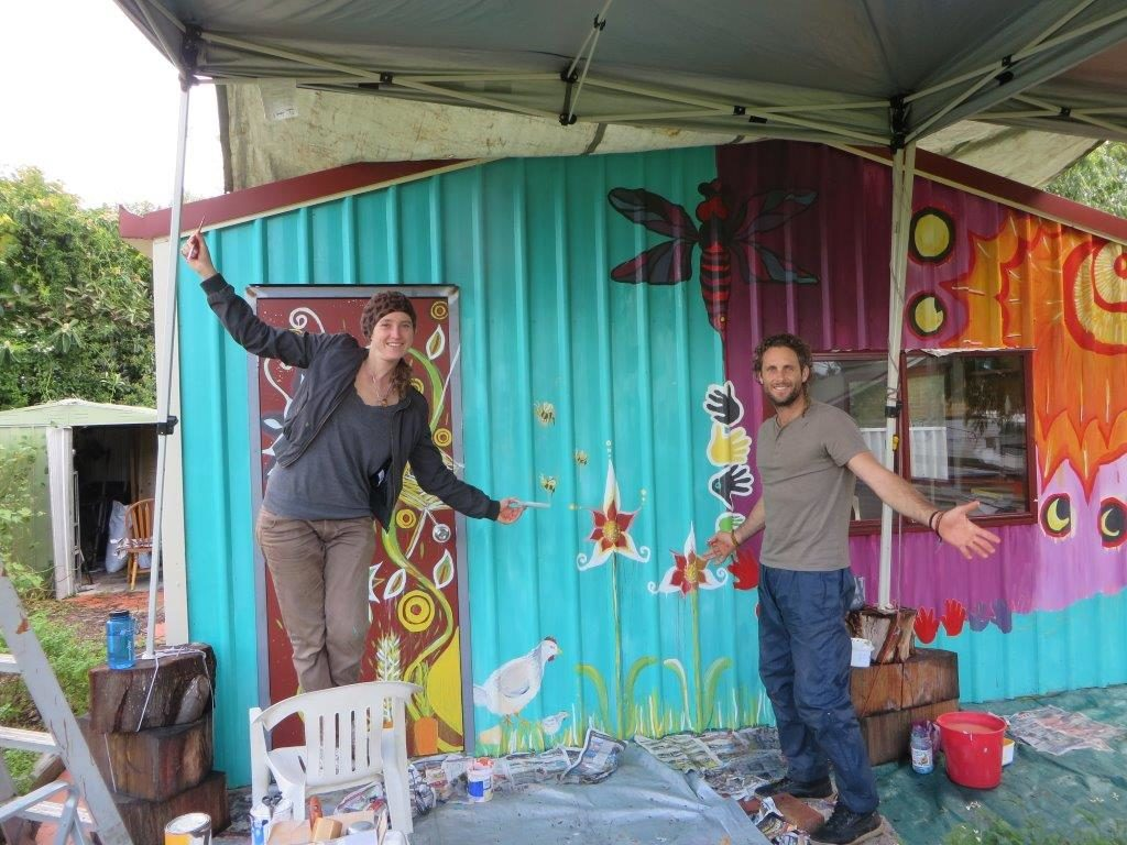 Painting a shed mural at Mia Mia Housing Coop garden